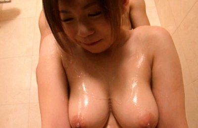 Konatsu Aozora is a horny Japanese doll rubs a hard cock with her big boobs