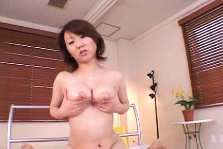 Asian Milf with big tits plays with cock in POV scenes