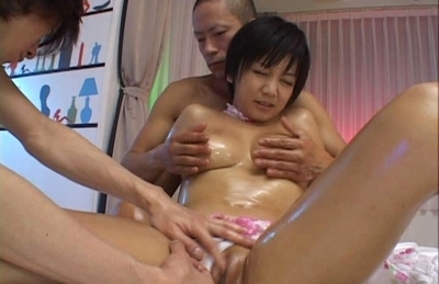 Meguru Kosaka Asian chick is oiled up and fucked in a threesome